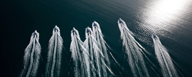 Bird view of game fishing boats in one row heading out to the Great Barrier Reefs
