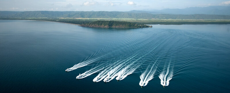 Bird view of Port Douglas with game fishing boats leaving marina